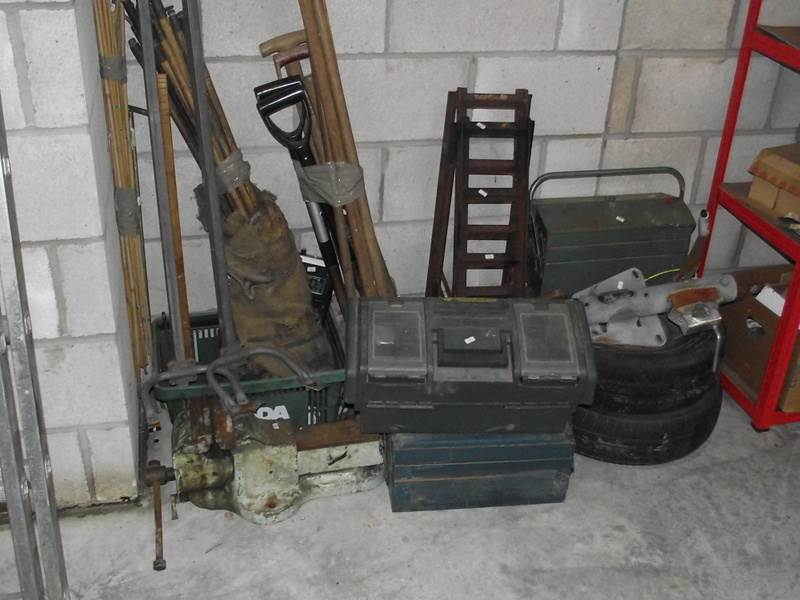 Lot 403 - A mixed lot including ramps, winch, tool boxes, large bench vice etc.
