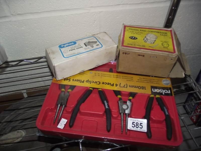 Lot 585 - A boxed piston ring compressor, 4 piece circlip pliers set etc.