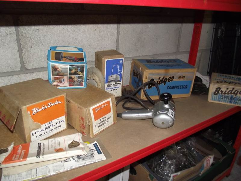 Lot 408 - A vintage Black & Decker drill with boxed attachments including Bridges compressor and spray gun.