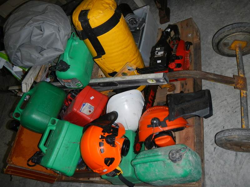 Lot 643 - Pallet contents including chain saw, fuel cans, tools etc.