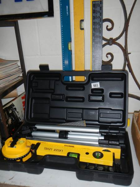 Lot 593 - A boxed Power Master laser level etc., including set squares and spirit level.