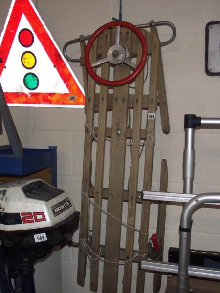 Lot 568 - An old steerable sledge.
