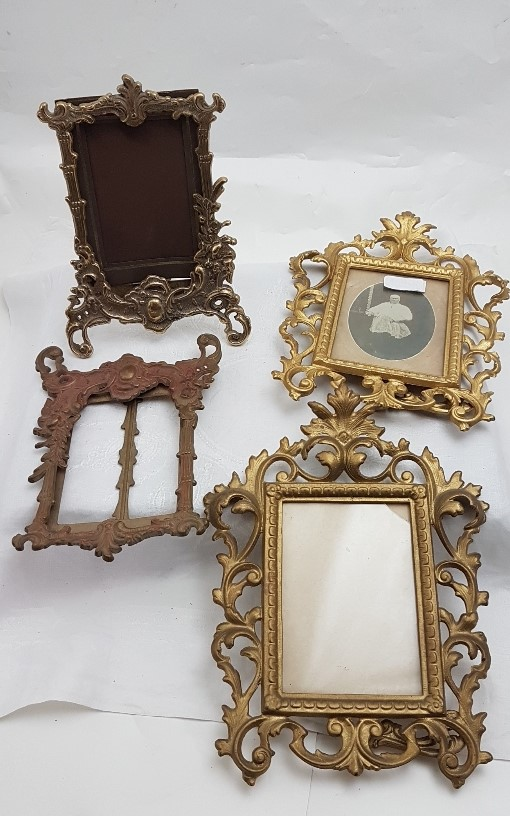 Lot 554 - Two pairs of brass Photo Frames, both ornately detailed