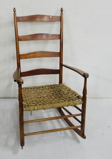 Lot 21 - Plantation style walnut Rocking Chair, waved ladder back, with weaved rope seat, 62cm wide
