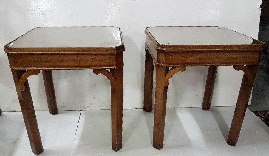 "Lot 2 - A pair of figured walnut lamp tables on chamfered supports, each 18"" sq"