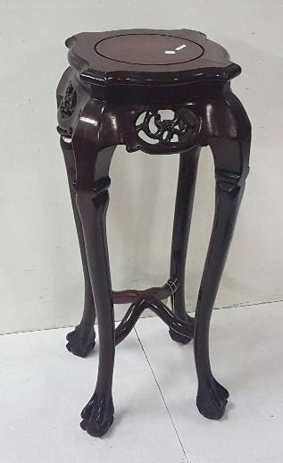 Lot 30 - Oriental cherrywood carved Plant Stand with shaped top on 4 ball and claw feet, 33cm h x 32cm w