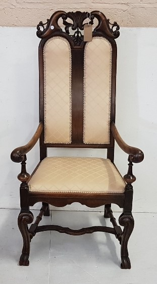 Lot 35 - Early 20th C Carolean style walnut Armchair, tall back, cream padded seat and double panel padded