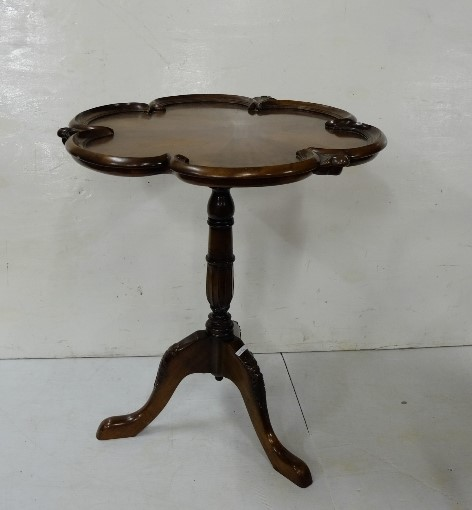 Lot 29 - Reproduction mahogany pedestal table with shaped moulded top above a turned & carved column
