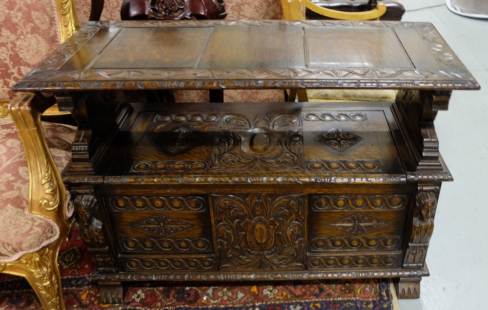 Lot 32 - Victorian carved oak Monk's Bench, the hinged top opening to reveal 2 lion shaped bench arms and a