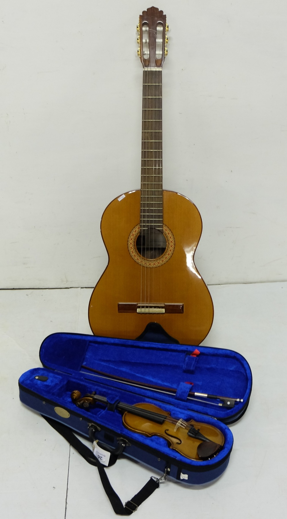 "Lot 26 - A Manuel Rodriguez six string acoustic guitar and Stentor 10.25"" student violin with bow in fitted"