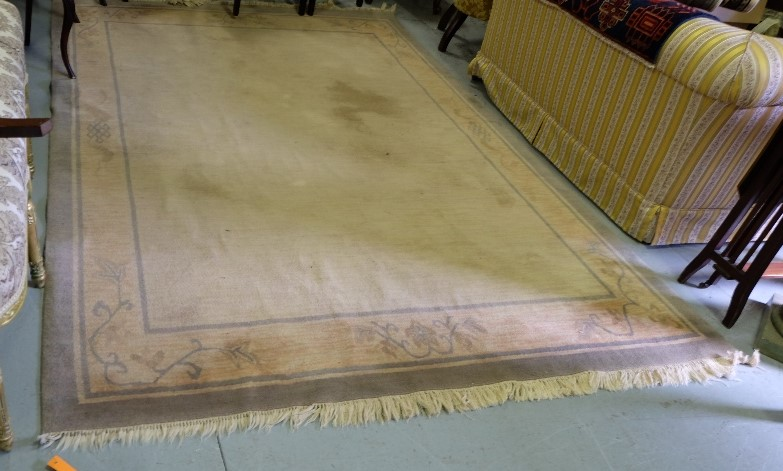 Lot 42 - A pair of woollen Floor Rugs, each beige and terracotta with green borders, each 1.85m x 2.9m (2)