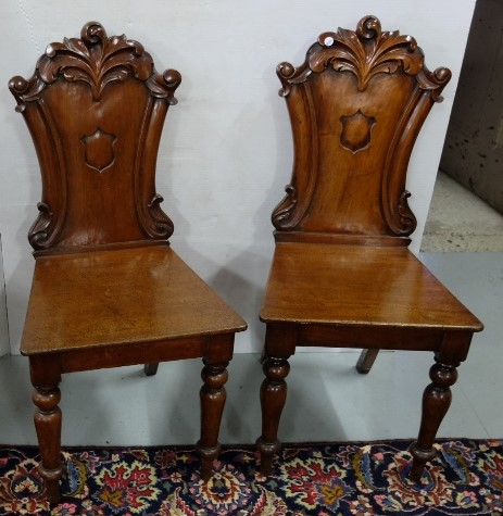 Lot 38 - Matching Pair of late 19thC Mahogany Hall Chairs with acanthus mouldings over shield shaped