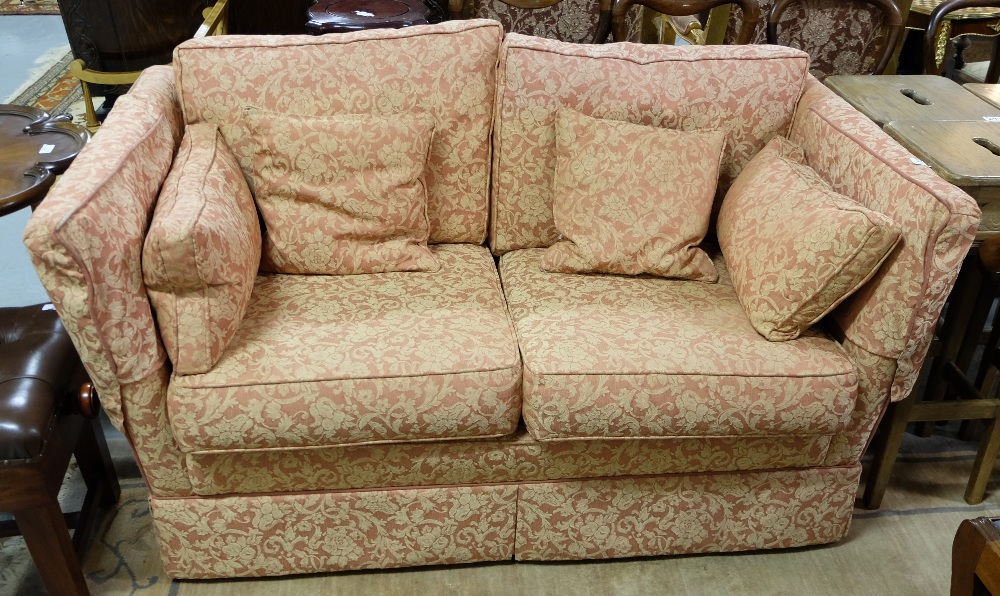 Lot 25 - Peter Guild Parker Knole type sofa, having floral rust coloured damask upholstery with loose
