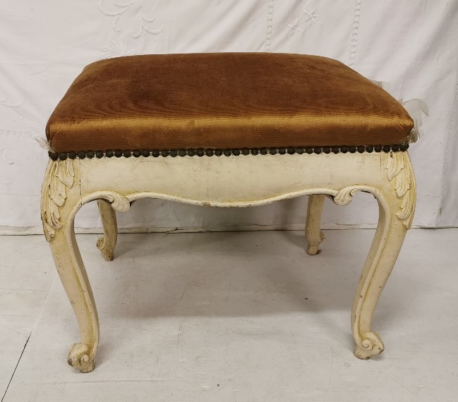Lot 12 - Carved pine stool, painted cream with gold padded seat 60cm wide
