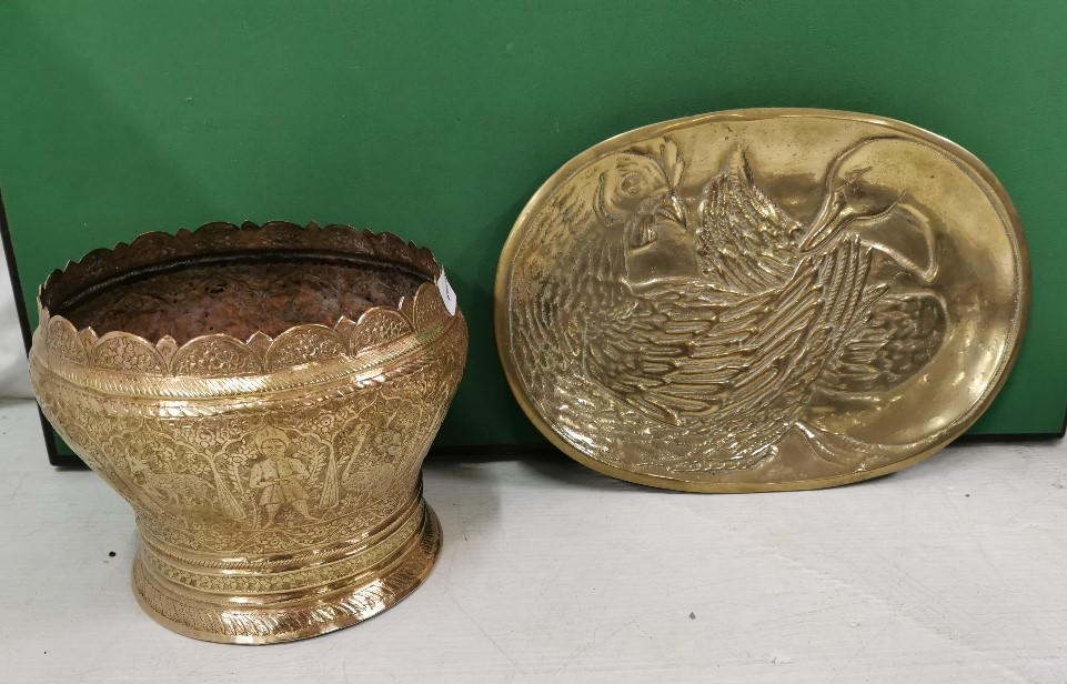 Lot 27 - A Persian Brass Jardinere, bulbous shaped – impressed with deers, birds and figures of men 18cm x