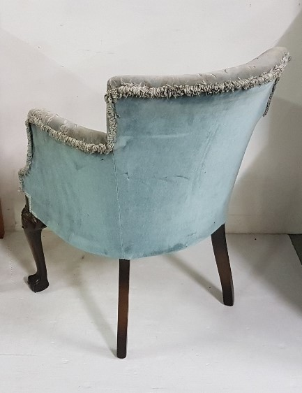 Lot 6 - Carved and upholstered tub chair on ball and claw feet, blue floral upholstery, 60cm w x 80cm h