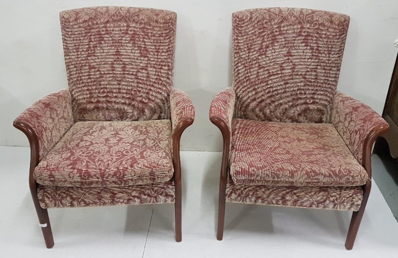 Lot 2 - Matching pair Parker Knoll red floral armchairs, on tapered legs