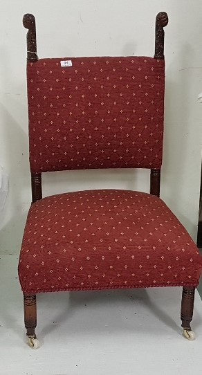Lot 16 - 19th C upholstered low chair with extended back supports, red fabric upholstery, porcelain castors