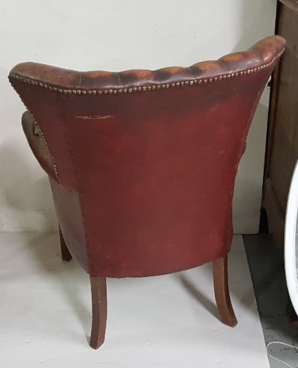 Lot 3 - Highback Armchair, with brass studs to back and sides, worn red leather upholstery, tapered legs