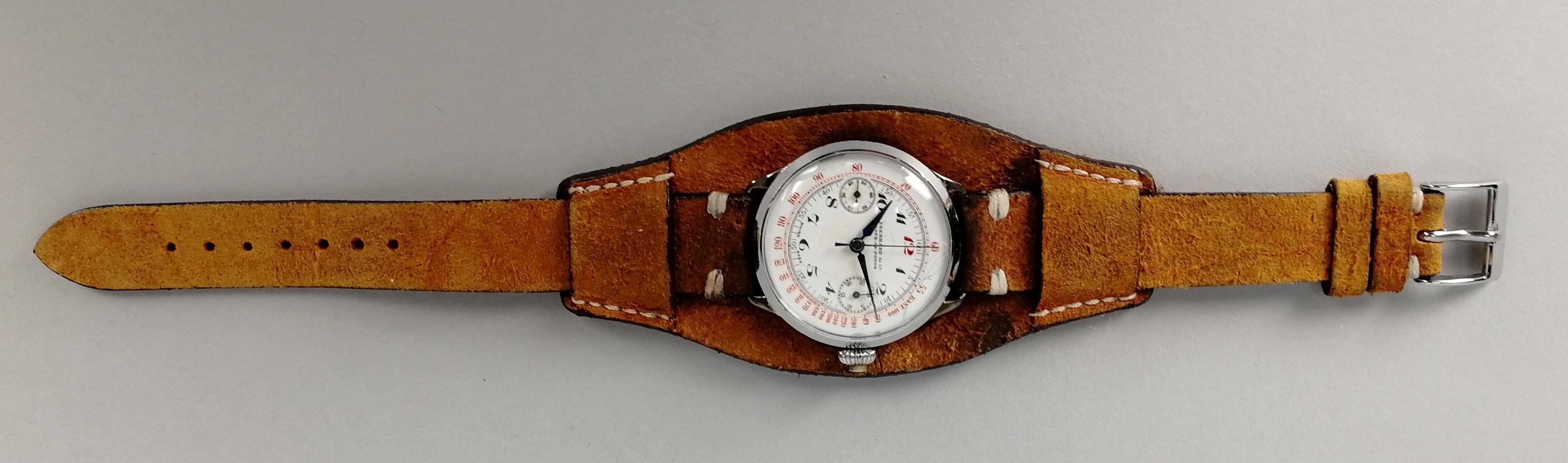 Lot 23 - EBERHARD. Orologio in argento 800, modello cronografo monopulsante. Quadrante in ceramica a due