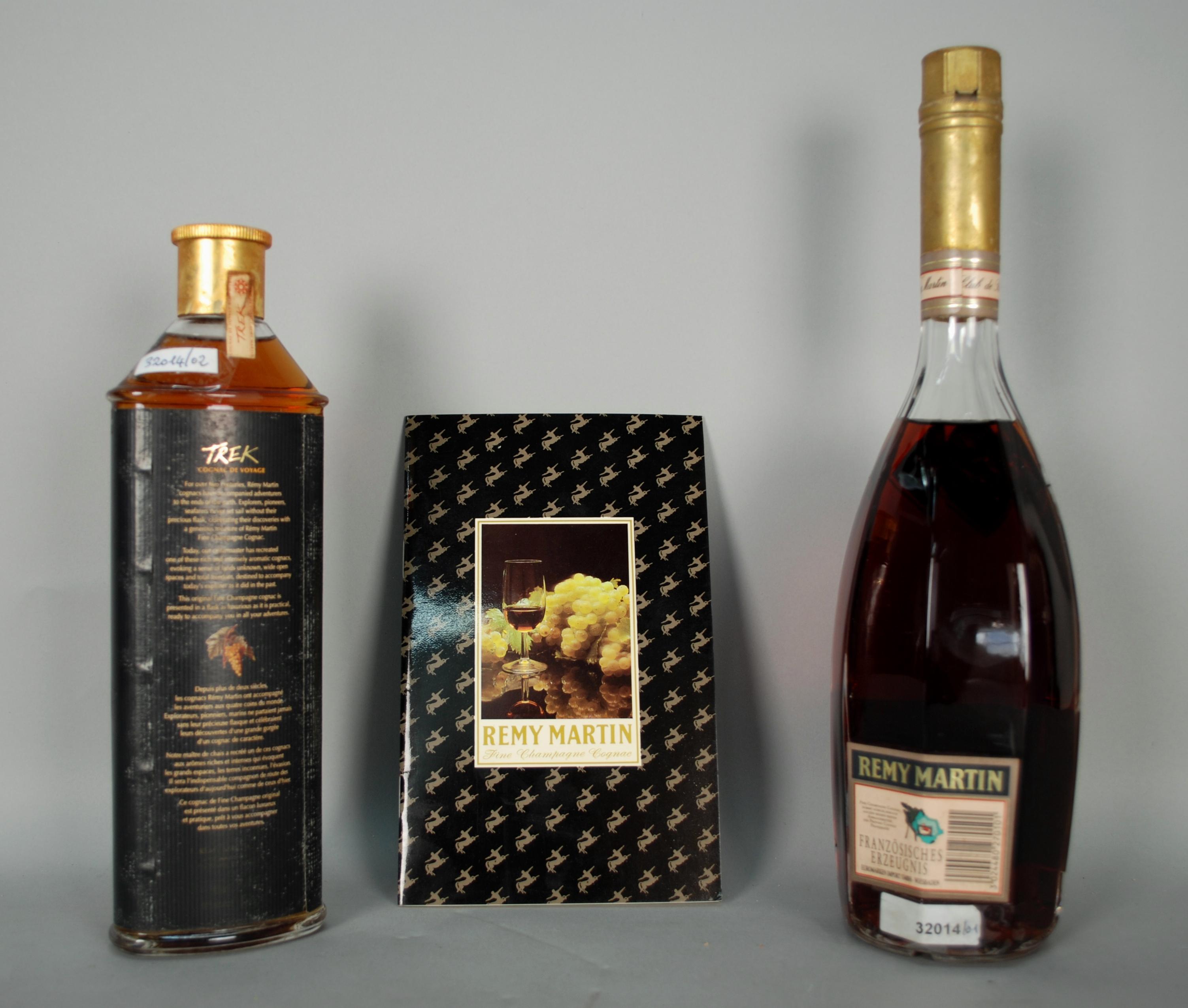 Lot 51 - Due Cognac REMY MARTIN con libretto: - Cognac TREK. Fine Champagne. Inizi anni 2000. Flacone da