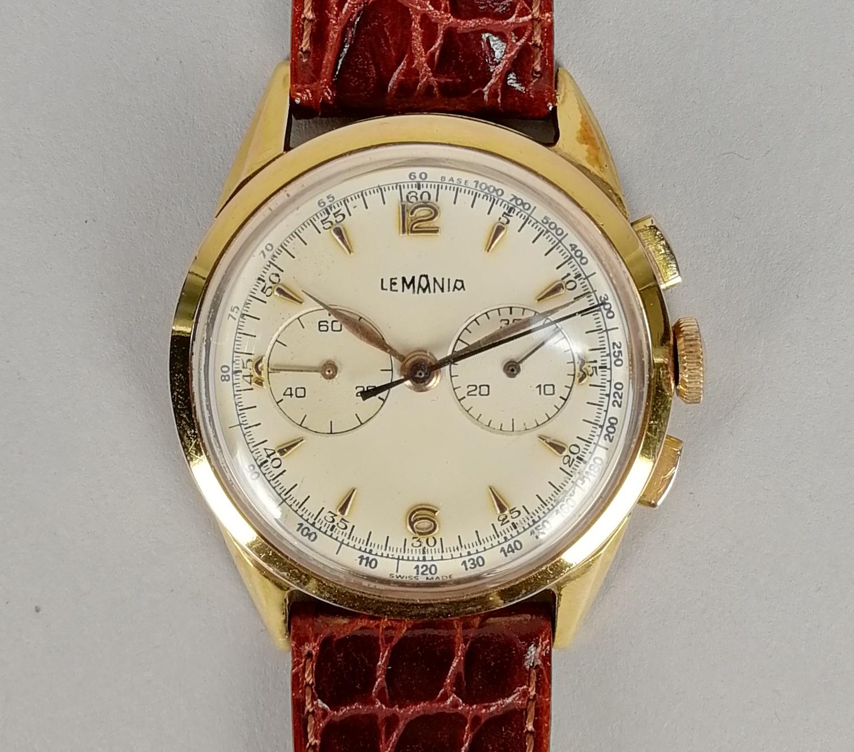 Lot 28 - LEMANIA. Orologio da uomo in oro giallo 18 kt., modello cronografo classico a carica manuale.