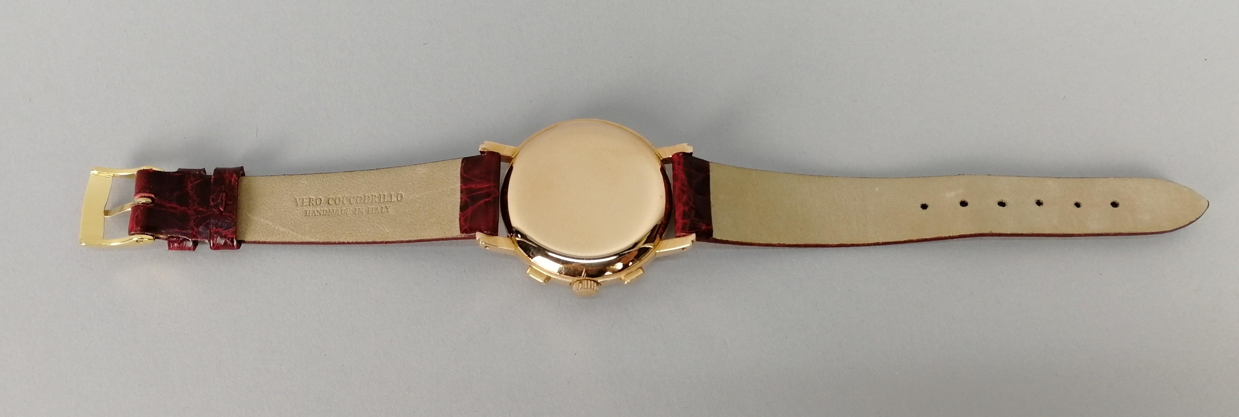 Lot 33 - MOVADO. Orologio da uomo in oro rosa 18 kt. Cronografo a due contatori C90M. Quadrante originale