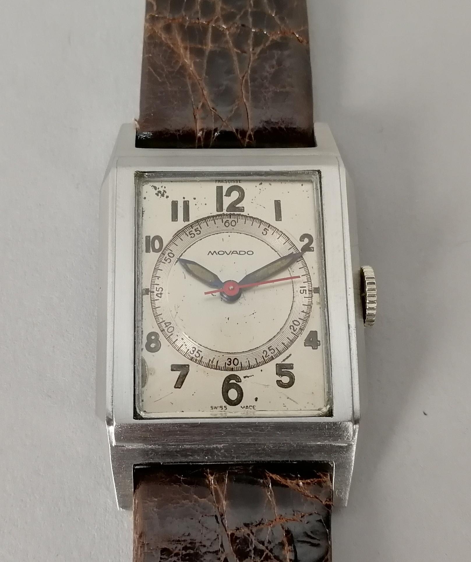 Lot 32 - MOVADO. Orologio da uomo in acciaio di forma rettangolare. Quadrante originale. Epoca 1950.