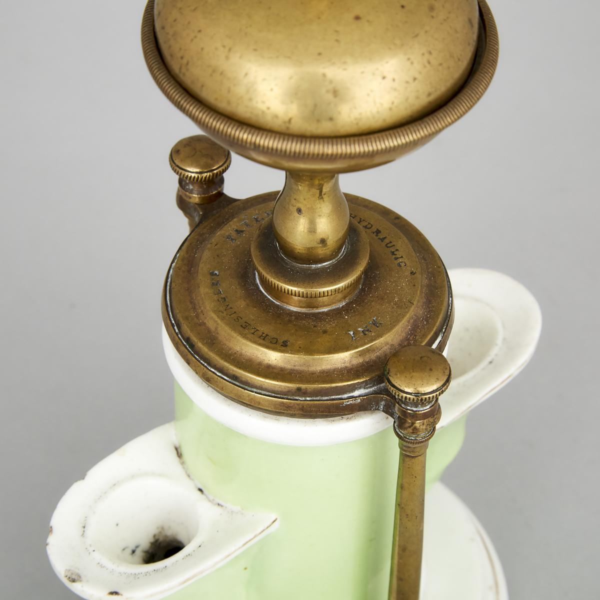 Lot 113 - Joseph Schlesinger's Patent Hydraulic Ink Pot, mid 19th century, height 9 in — 22.9 cm
