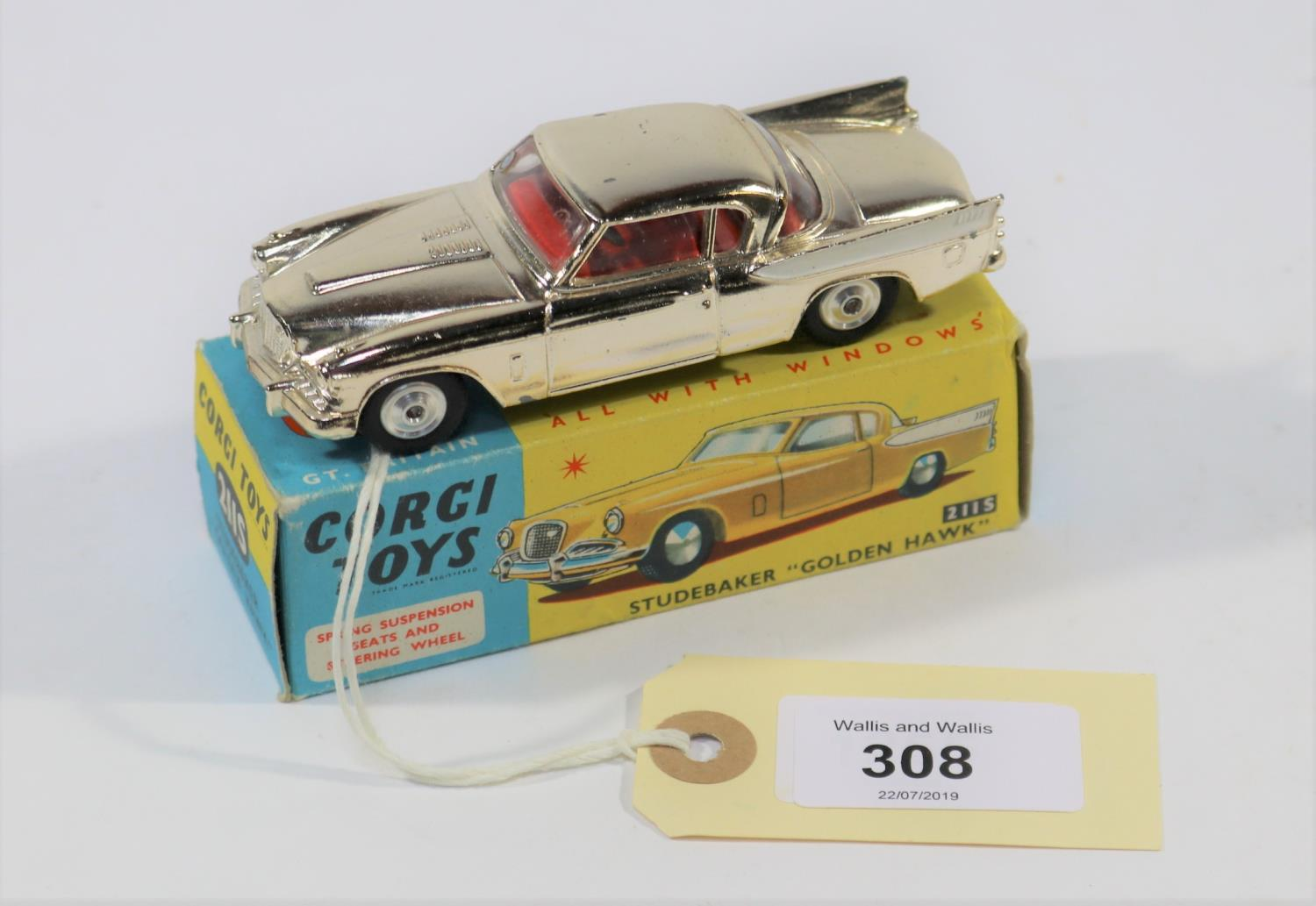 Lot 308 - Corgi Toys Studebaker Golden Hawk (211S). In gold wash vacuum plated finish, with white flash and