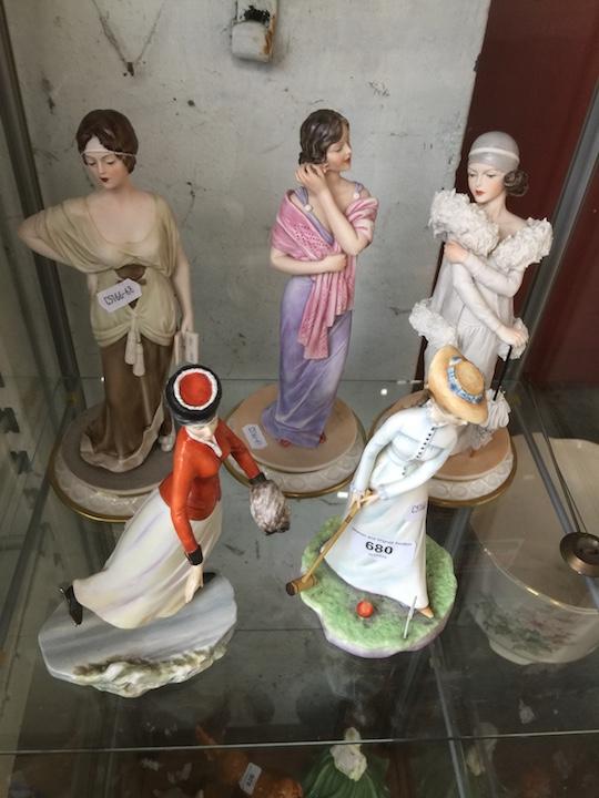 Lot 680 - Five Royal Doulton lady figurines