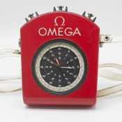 AN OMEGA SPLIT SECONDS CHRONOGRAPH TIMER IN ORIGINAL FITTED PLASTIC CASE WITH SHOULDER STRAP CIRCA