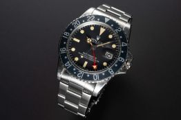 A RARE GENTLEMAN'S STAINLESS STEEL ROLEX OYSTER PERPETUAL GMT MASTER BRACELET WATCH CIRCA 1973, REF.