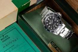 """A VERY RARE GENTLEMAN'S STAINLESS STEEL ROLEX OYSTER PERPETUAL DATE """"RED WRITING"""" SUBMARINER"""