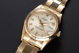 A GENTLEMAN'S 18K SOLID YELLOW GOLD ROLEX OYSTER PERPETUAL DATE BRACELET WATCH CIRCA 1986, REF.