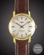 A GENTLEMAN'S 18K SOLID GOLD LONGINES FLAGSHIP AUTOMATIC WRIST WATCH CIRCA 1961, REF. 3404 WITH