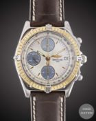 A GENTLEMAN'S SIZE STEEL & GOLD BREITLING CHRONOMAT WRIST WATCH CIRCA 2000s, REF. D13050.1 WITH