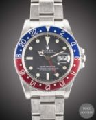 A GENTLEMAN'S STAINLESS STEEL ROLEX OYSTER PERPETUAL GMT MASTER BRACELET WATCH CIRCA 1980s, REF.