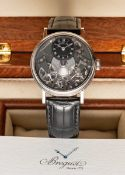 A FINE GENTLEMAN'S 18K SOLID WHITE GOLD BREGUET TRADITION SKELETON POWER RESERVE WRIST WATCH DATED