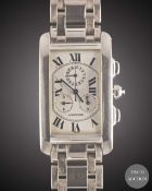 A GENTLEMAN'S 18K SOLID WHITE GOLD CARTIER TANK AMERICAINE CHRONOGRAPH BRACELET WATCH CIRCA 2000,