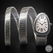 A LADIES STAINLESS STEEL BULGARI SERPENTI TUBOGAS DOUBLE SPIRAL BRACELET WATCH CIRCA 2010, WITH