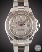 A GENTLEMAN'S STAINLESS STEEL & PLATINUM ROLEX OYSTER PERPETUAL DATE YACHT MASTER BRACELET WATCH