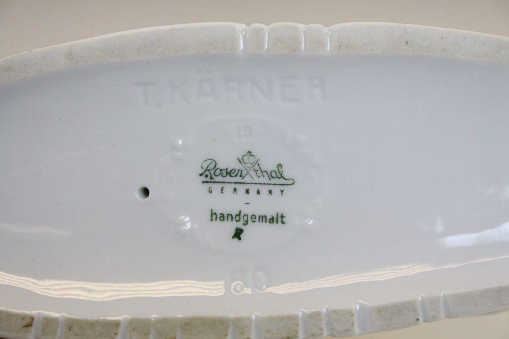 Lot 24 - A Rosenthal recumbent porcelain whippet impressed Karner and no.80 to underside