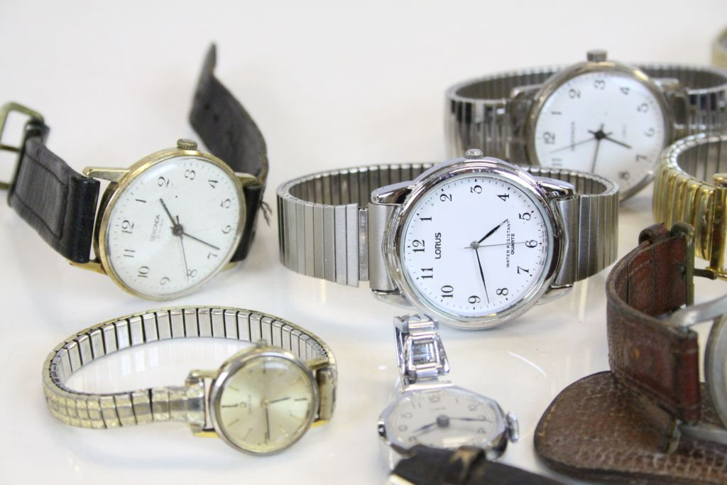 Lot 237 - A collection of vintage watches to include Smith's Empire, Girard Perregaux & Helsa.