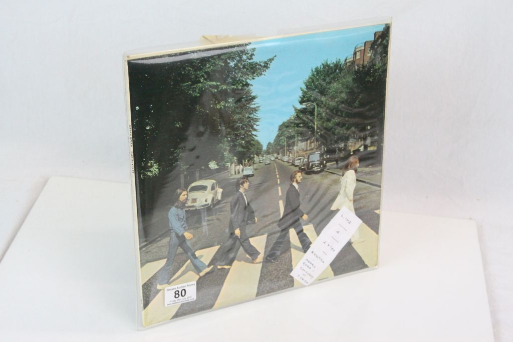 Lot 80 - Vinyl - The Beatles - Two LP's to include Abbey Road (PCS 7088) misaligned Apple logo, Her Majesty