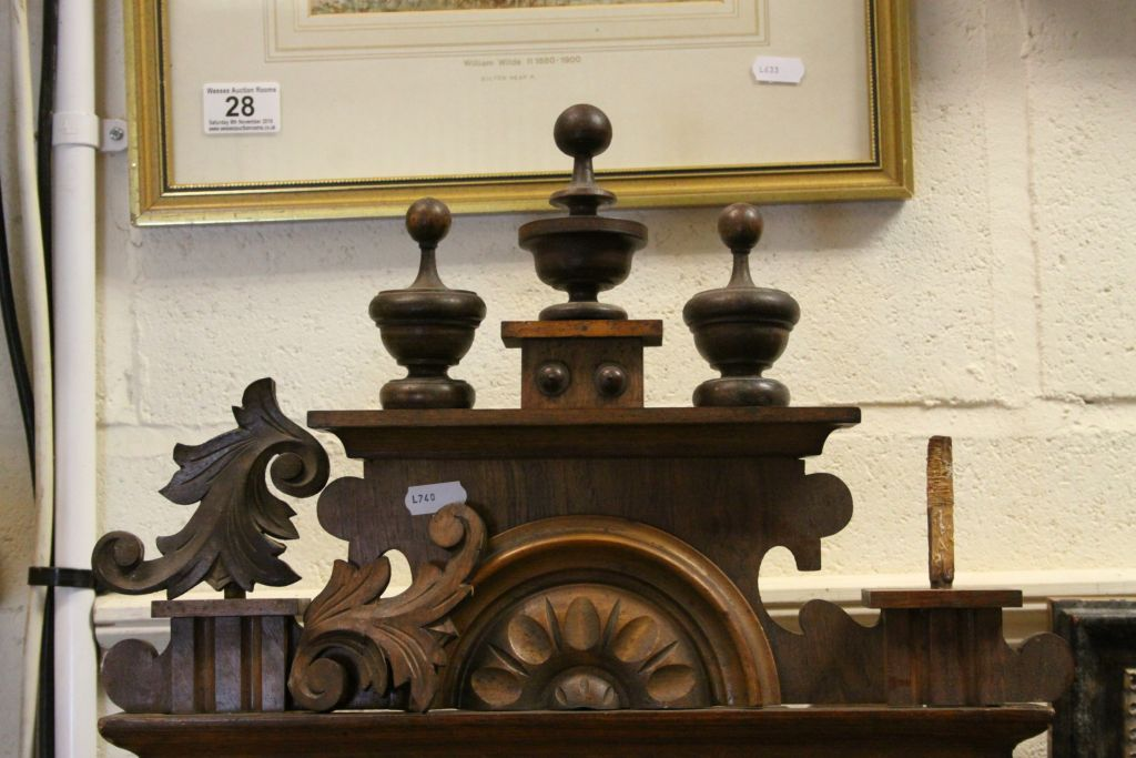 Lot 30 - Large ornate wooden cased Key wind striking Wall Clock, measures approx 92 x 36 x 17.5cm at the
