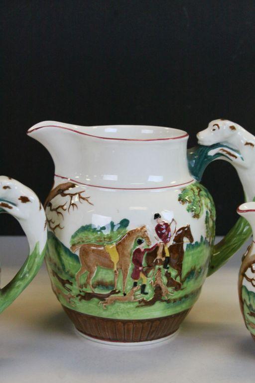 Lot 1 - A set of three Wedgwood D'Ye Ken John Peel graduating jugs with fox hunting scenes