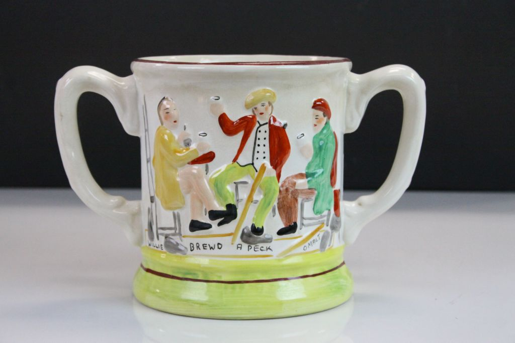 """Lot 13 - 19th Century Staffordshire twin handled Loving Cup with figural decoration & marked """"Willie Brewd"""