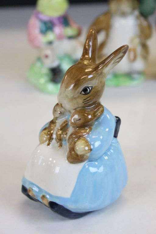 Lot 23 - Six Beswick ceramic Beatrix Potter figurines to include; Mrs Tiggy Winkle, The Old Woman who Lived