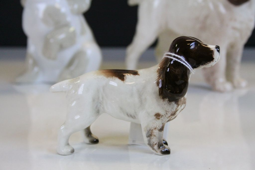 "Lot 11 - Two Beswick ceramic Spaniels, largest approx 14cm tall & a ""Valencia"" ceramic Puppy"